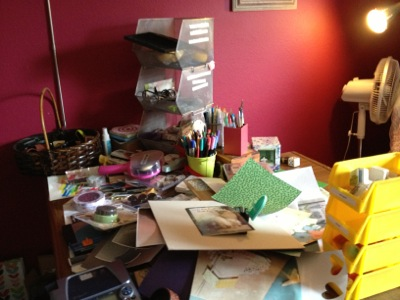 A cluttered craft desk before team help