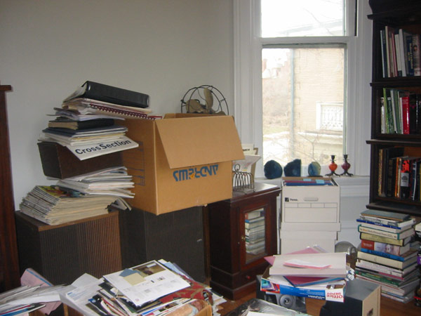 Messy home office with piles