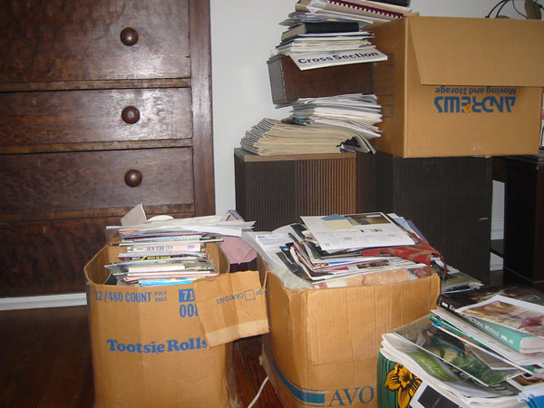 Boxes and piles of magazines and documents